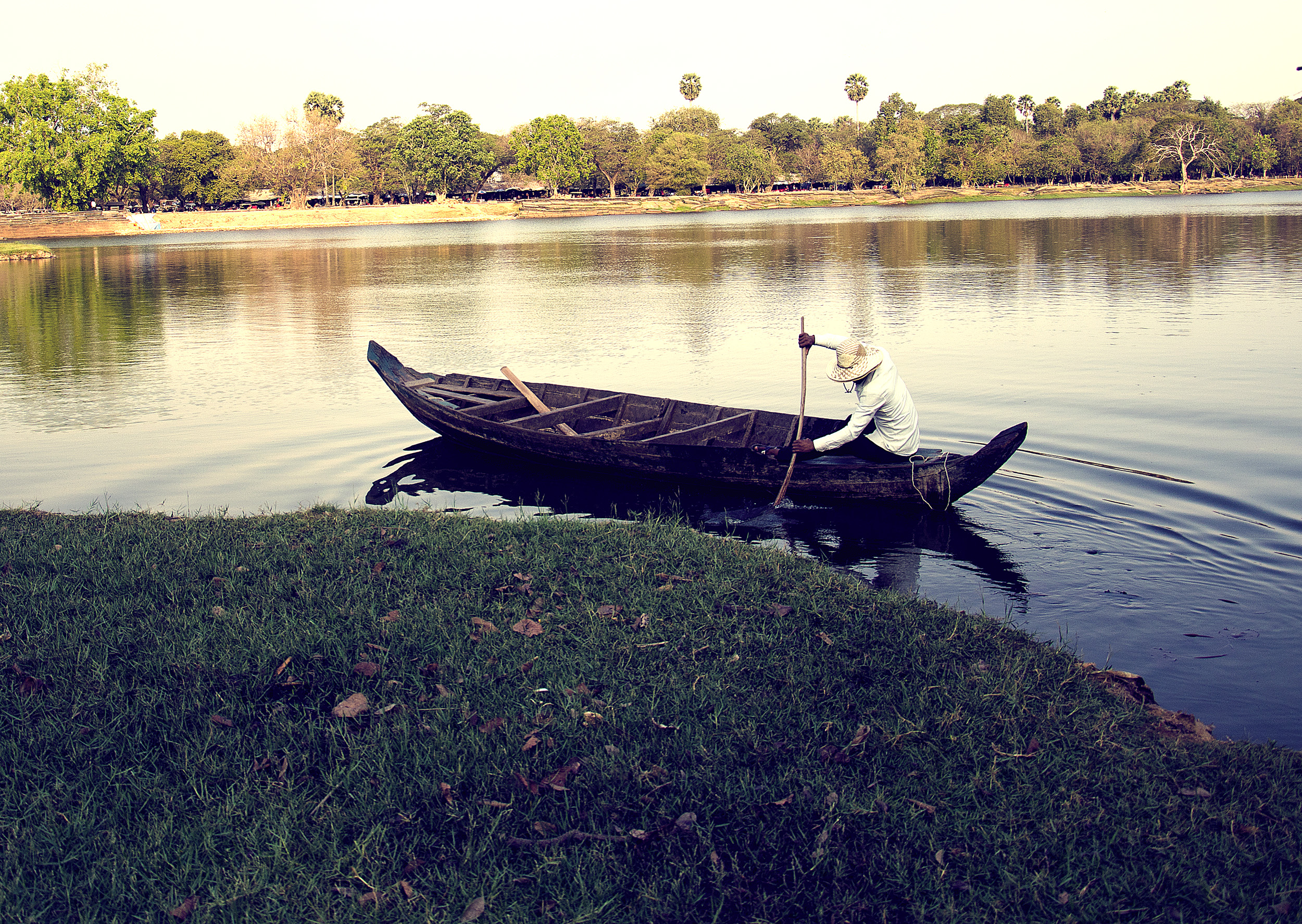 Dugout Canoe being paddled across the moat at Angkor.